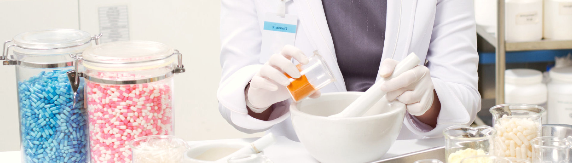 A pharmacist preparing medication with mortar