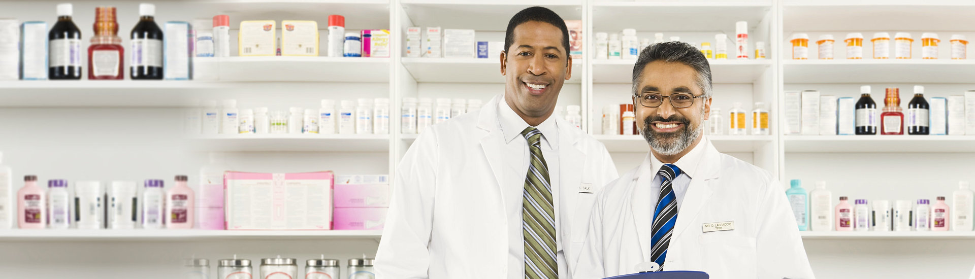 Portrait of two male pharmacists